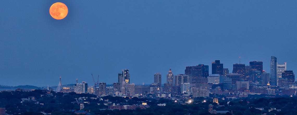 Boston skyline at night under a full moon © Ramkumar Subramanian