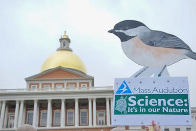 Mass Audubon sign at March for Science Boston