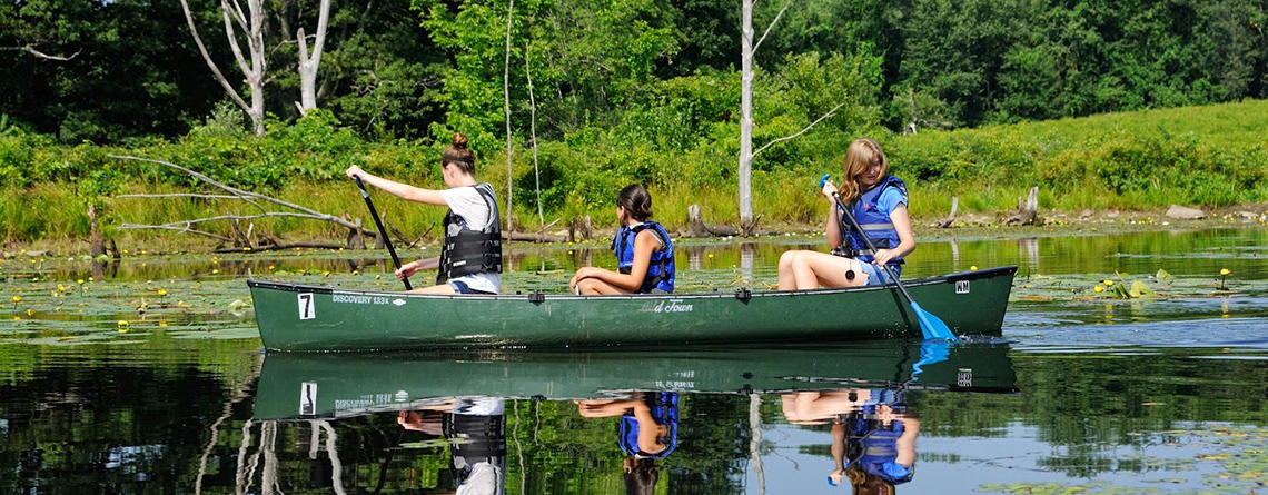 Teen girls canoeing at Wachusett Meadow Wildlife Sanctuary