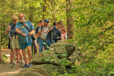 Group of people hiking an All Persons Trail at Habitat Education Center