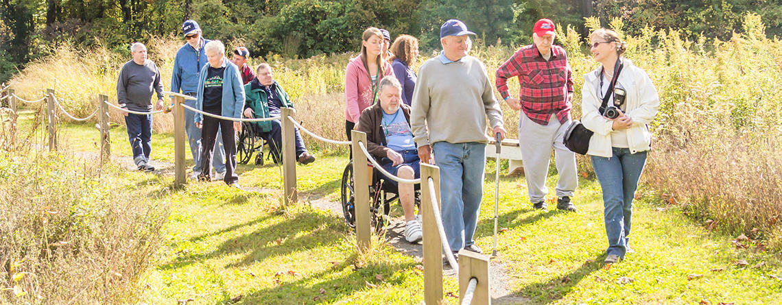 Group exploring an accessible trail at Arcadia Wildlife Sanctuary