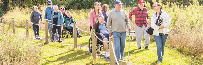 Group exploring an accessible trail