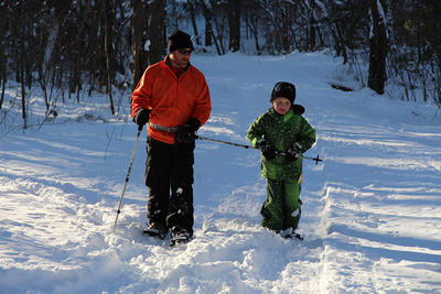 Parent & child snowshoeing together