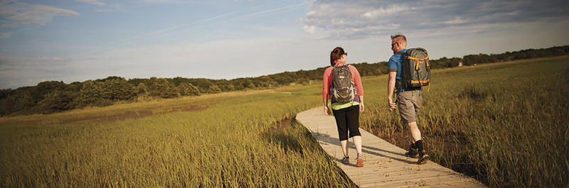 Young couple hiking at Wellfleet Bay Wildlife Sanctuary