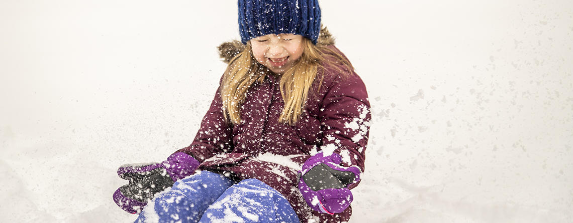 Young girl playing & laughing in snow at Arcadia Wildlife Sanctuary © Phil Doyle