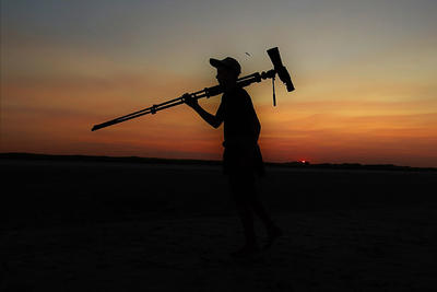 Young birder with scope silhouette at sunset © Andy Eckerson