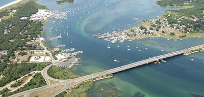 Aerial view of waterway bridge in Westport MA