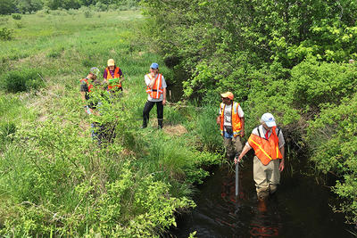 Participants in the field during a training focused on culverts in the Taunton watershed