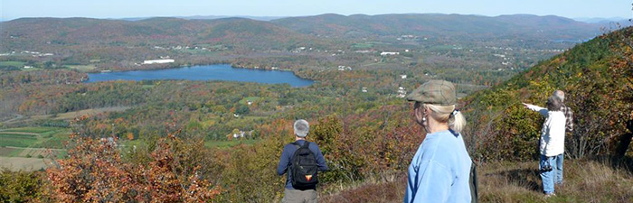 Adults hiking at Pleasant Valley Wildlife Sanctuary
