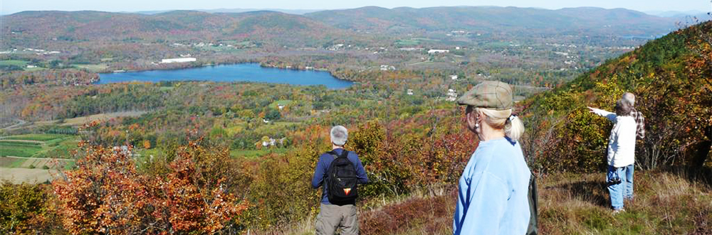 Adults hiking at Pleasant Valley Wildlife Sanctuary in autumn