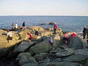 people playing on the rocks
