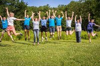 Arcadia's camp & education staff jumping for joy
