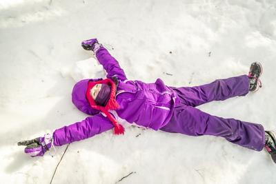 Girl making a snow angel at Arcadia Wildlife Sanctuary © Phil Doyle