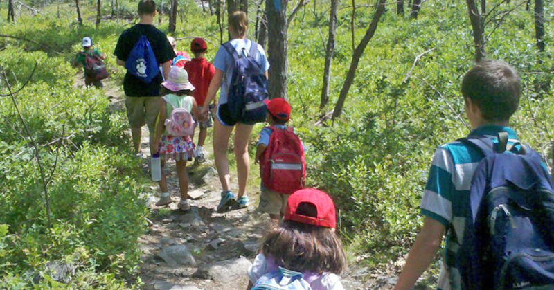 Blue Hills campers hiking a trail with camp staff