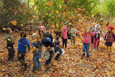 BNC preschoolers playing in fall leaves