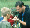Naturalist showing kids an insect