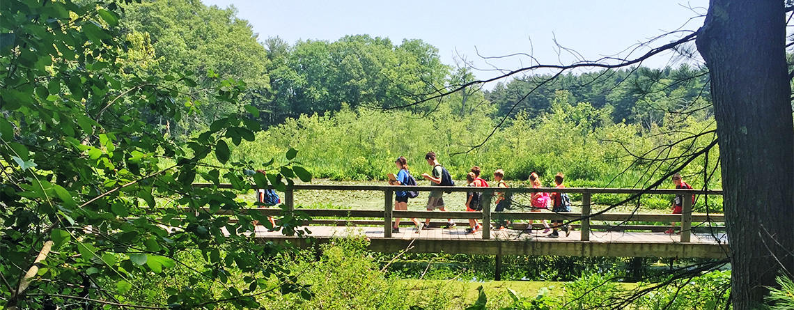 Broadmoor Discoverers campers crossing boardwalk