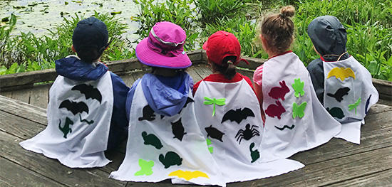 Broadmoor young campers with nature capes