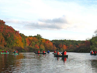 Canoeing on the Charles River in autumn
