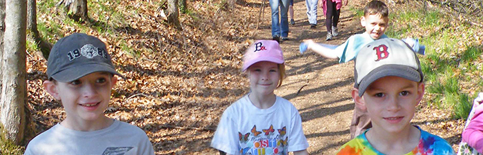 Kids on a trail at Broadmoor Wildlife Sanctuary