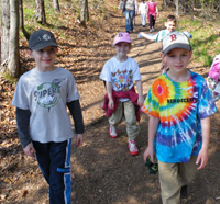 Kids walking in the woods at Broadmoor Wildlife Sanctuary