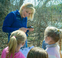 Scouts with a naturalist at Broadmoor Wildlife Sanctuary