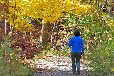 Walking a trail at Broadmoor in fall