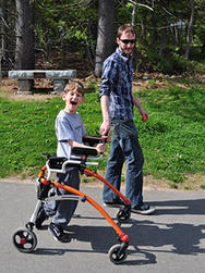 Child with walker on accessible path