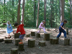 Kids playing on the stump jump at Drumlin Farm Wildlife Sanctuary