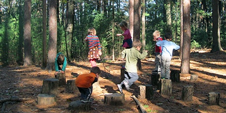 Children in a nature play space at Drumlin Farm Wildlife Sanctuary