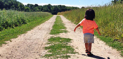 Toddler walking down Boyce Field Trail at Drumlin Farm © Jessica Forte
