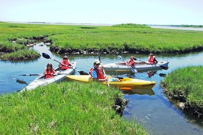 Family kayaking at Felix Neck © Justen Walker