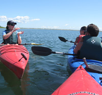 An education program on the water at Felix Neck Wildlife Sanctuary