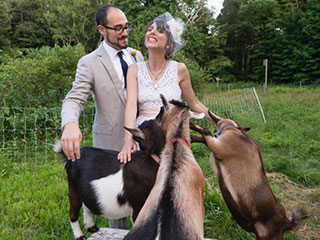 Wedding couple with Habitat goats © Anne Rearick