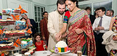 Cutting the cake at a wedding reception at Habitat © Anne Rearick