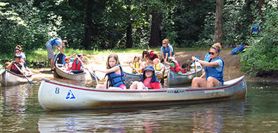 Campers canoeing at Ipswich River