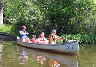 Campers canoeing at Ipswich River Wildlife Sanctuary Day Camp