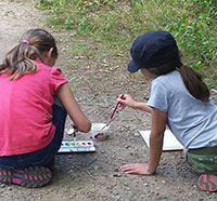 Girls painting on trail