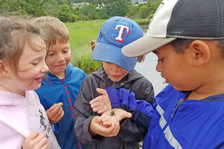 Kids inspecting a nature find