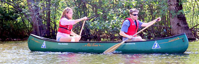 Two people canoeing at Ipswich River Wildlife Sanctuary