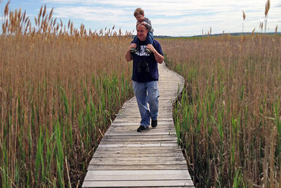 Exploring the marsh at Joppa Flats by piggyback © Jana Gauthier