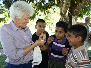 Woman showing kids a bird at Joppa Flats Education Center