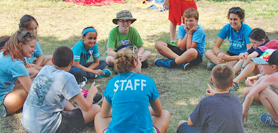 Joppa campers sitting in circle with staff
