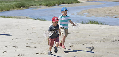 Kids running on the beach at Cape Cod