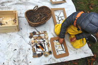 Preschooler making nature art at Long Pasture
