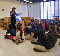 Museum of American Bird Art Staff teaching a lesson at a local school