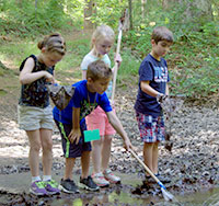 Group of kids at a vernal pool