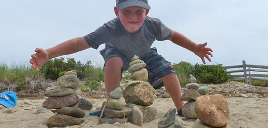 NR camper building rock cairns