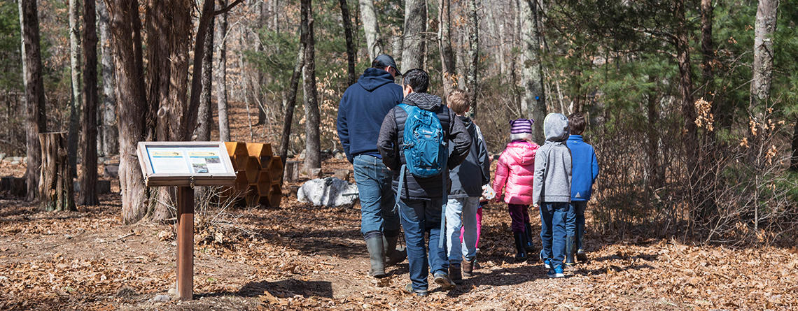 A school group walking the main trail in fall at Oak Knoll Wildlife Sanctuary