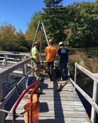 A repair crew working on the boardwalk